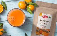 Rohkost-Saft mit Orangen und Kurkuma